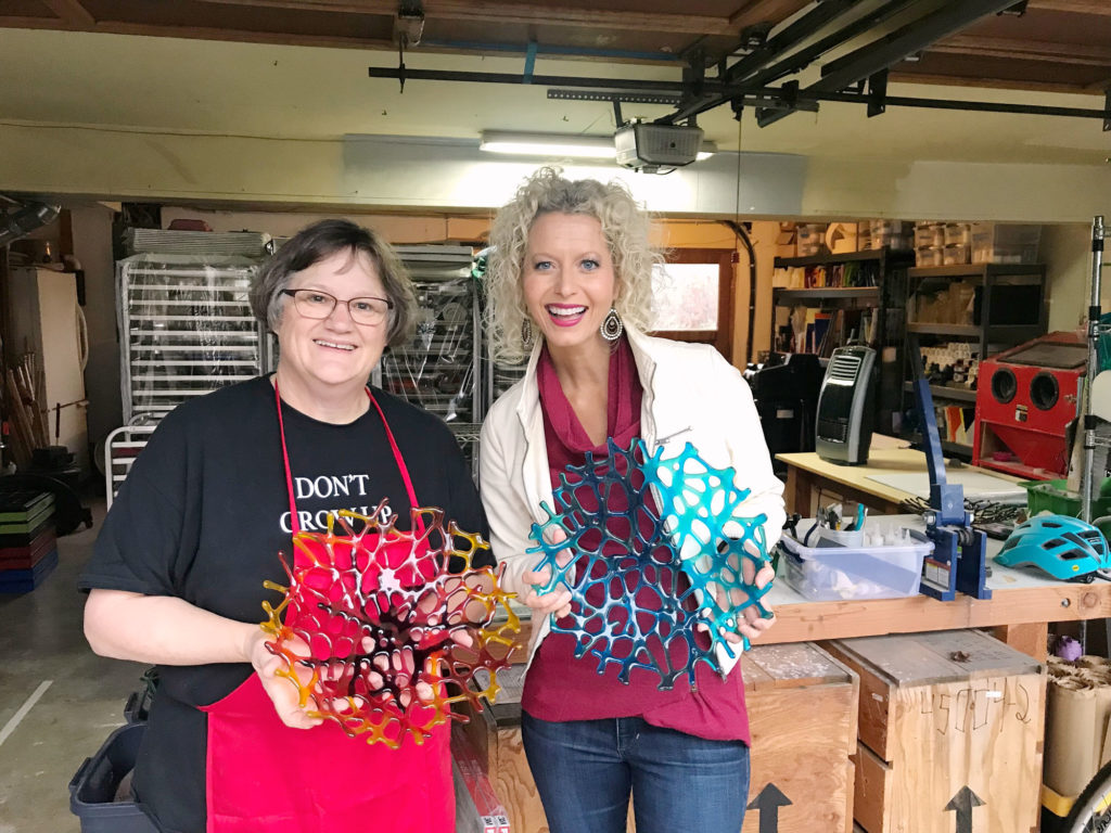 Organizing client and Vicki Norris holding glass sculptures