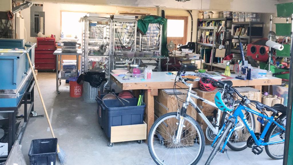 Organized garage with glass studio