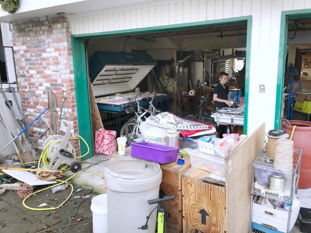 Garage with clutter outside