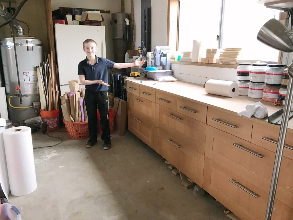 Client's son showing workbench