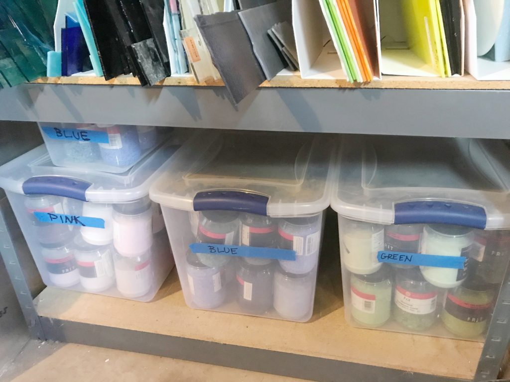 Organized sheets of glass and bins