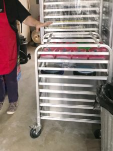 Organizing client showing small rolling rack