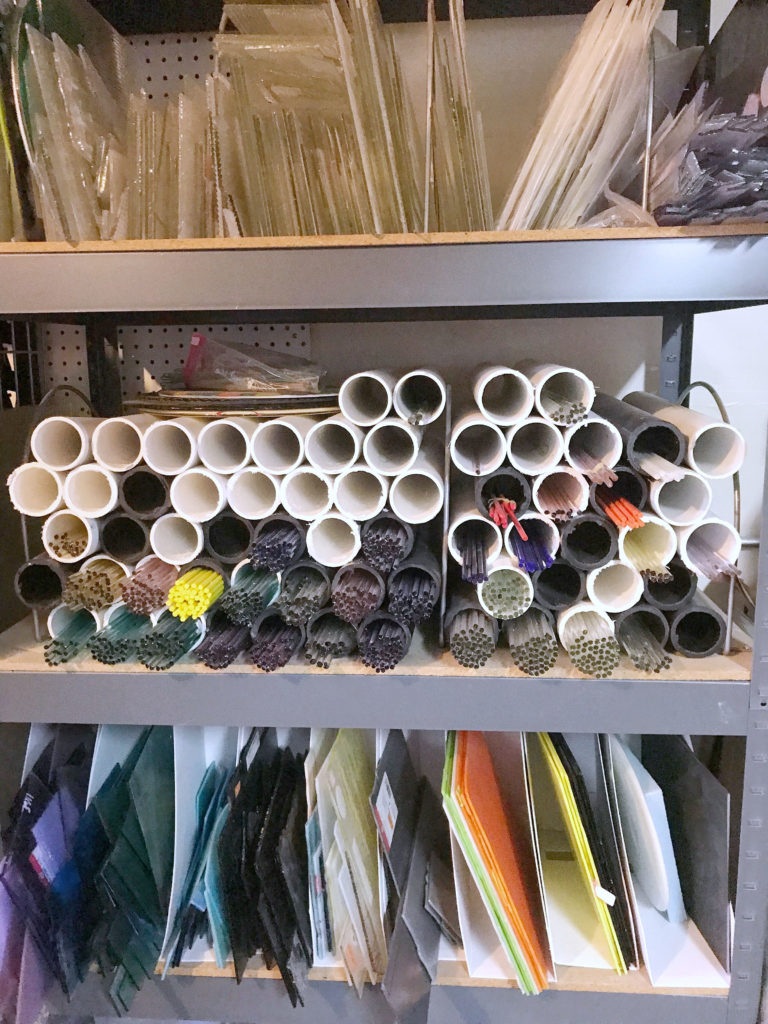 Glass rods and small sheets organized by color