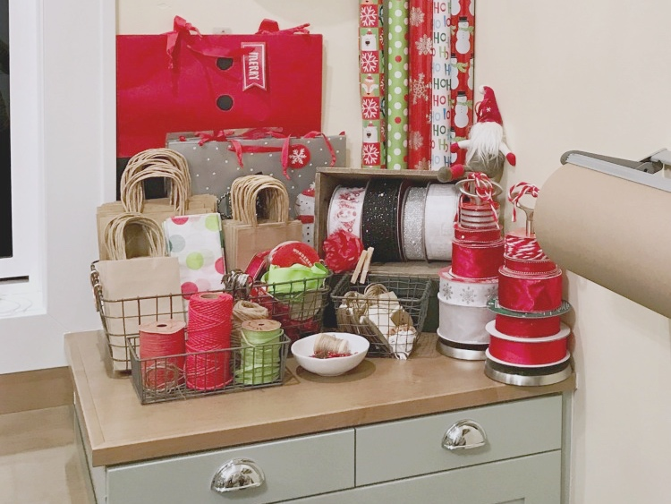 Organized gift center with ribbons, bags, and wrapping paper