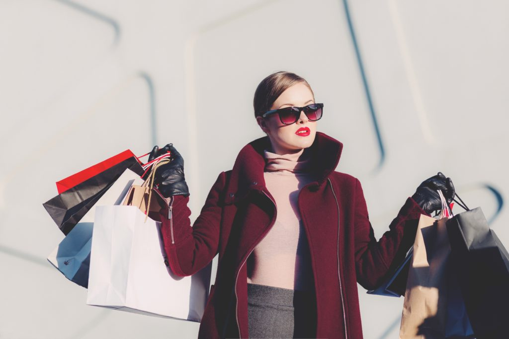 Woman shopping and wasting money