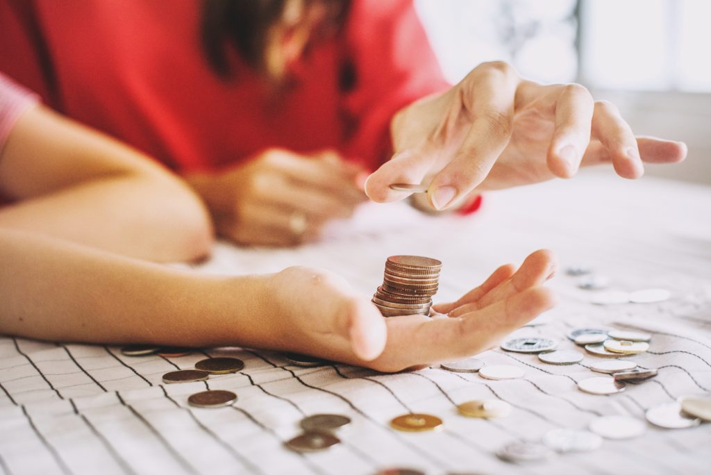 People counting money together to stop wasting money