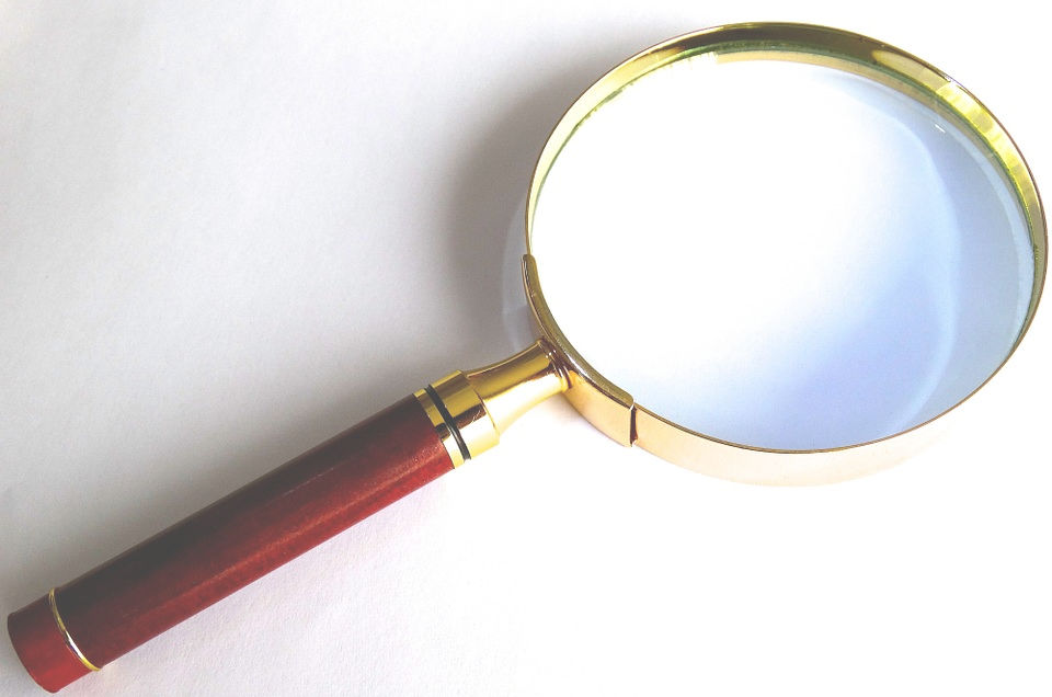 Magnifying glass - Organizing is Detective Work