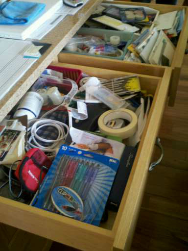Cluttered junk drawer of a Portland client