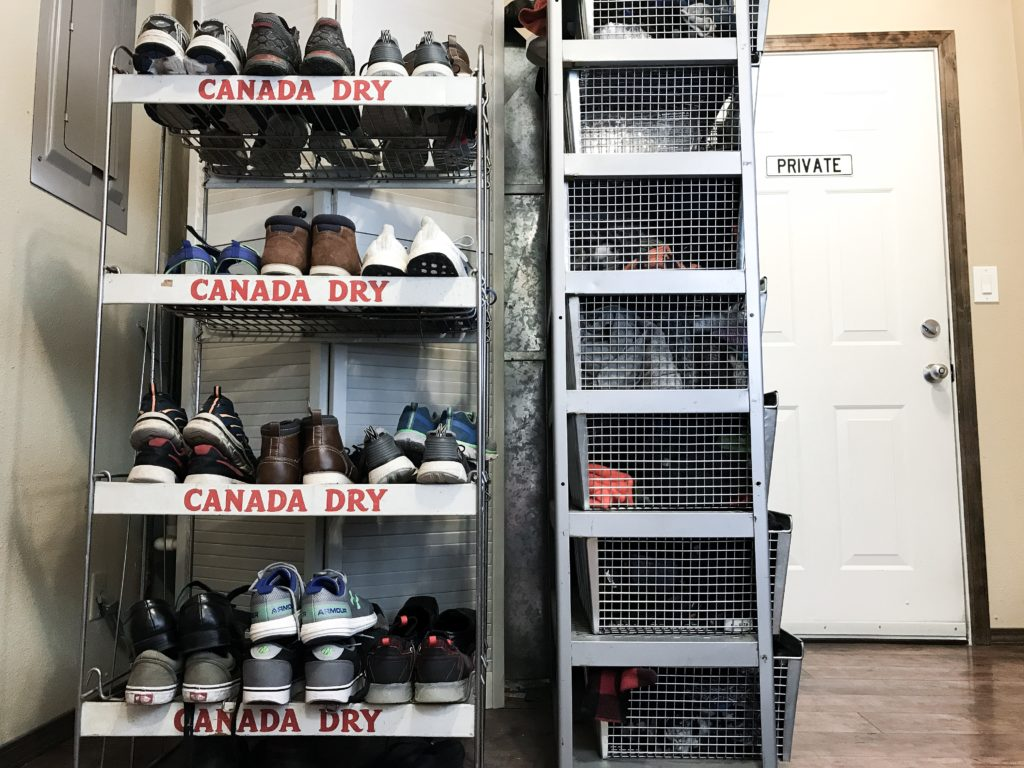 Shoe bar in mudroom