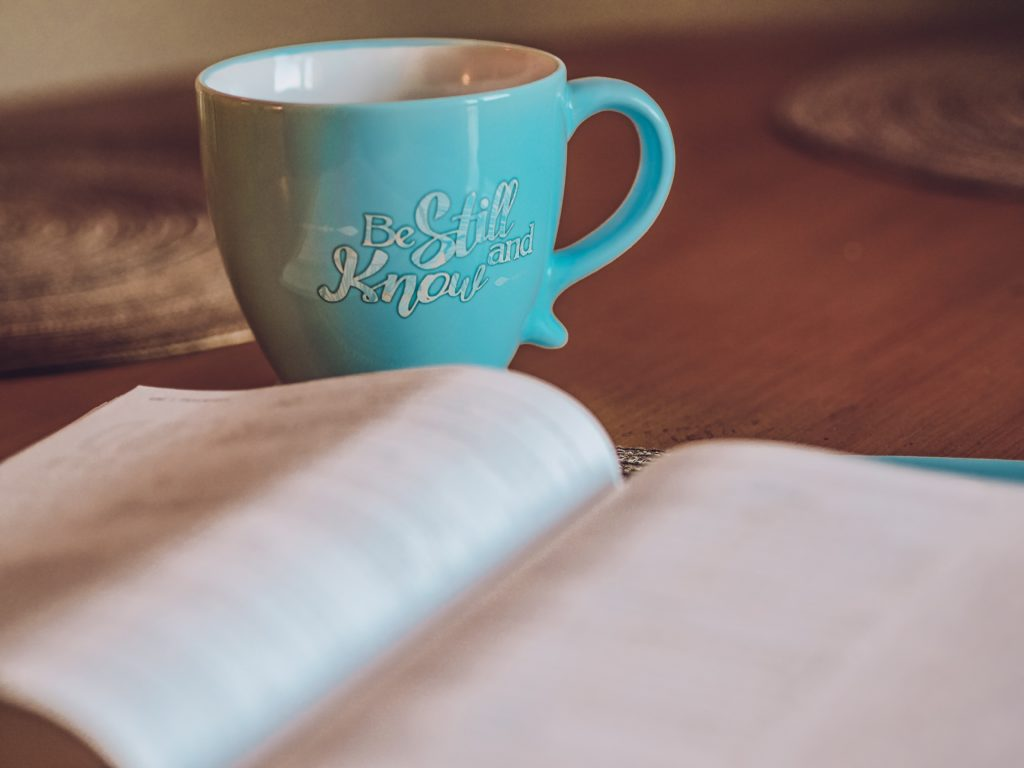 Mug and book with saying be still