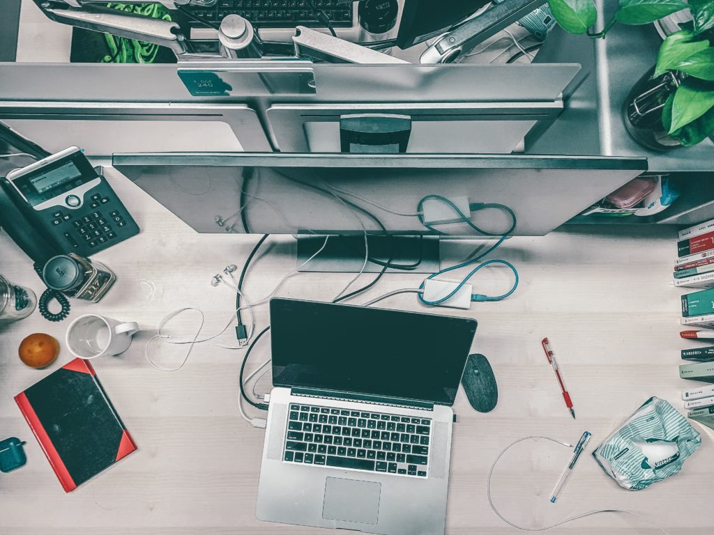 Desk messy with electronics
