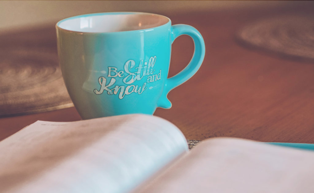 Mug and book time management tips