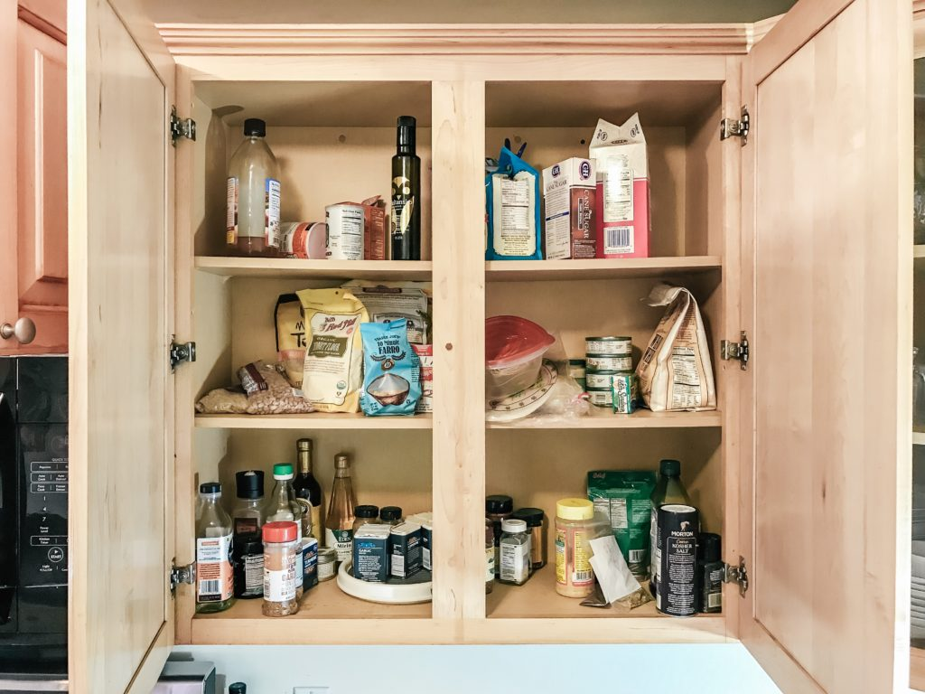 Cabinet with food before being organized