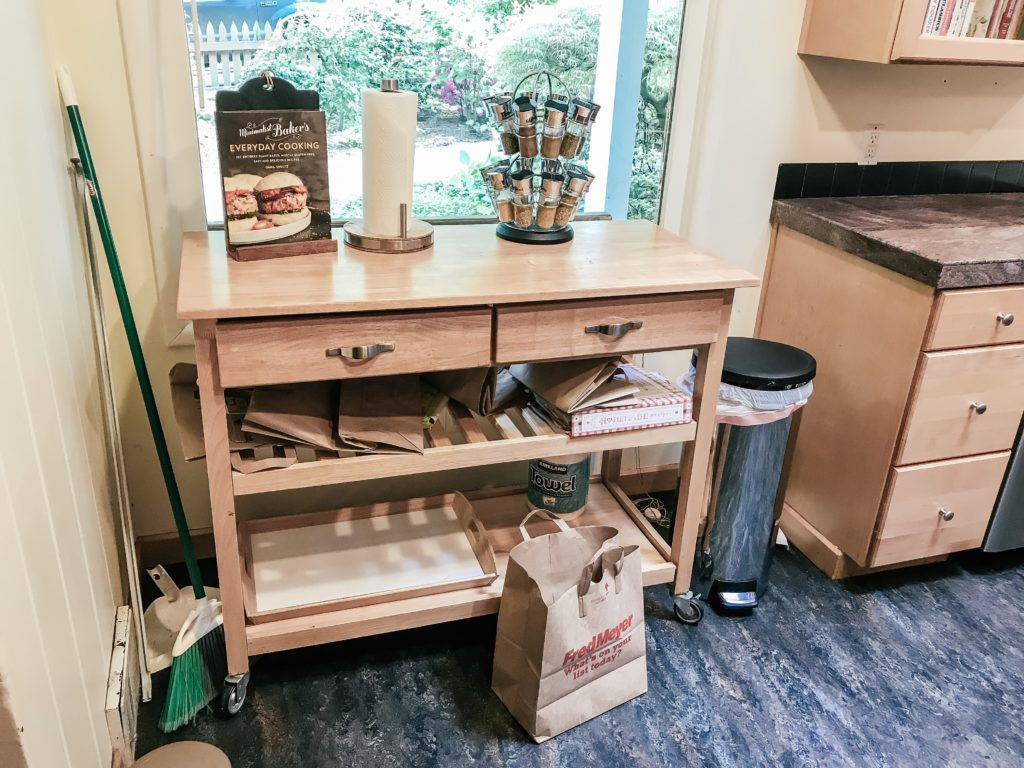 rolling cart with bags and recipes