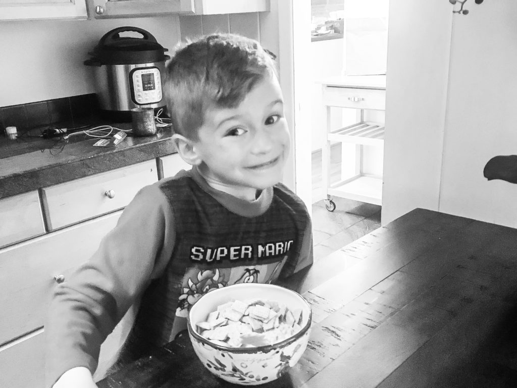 Stephanies son eating at table
