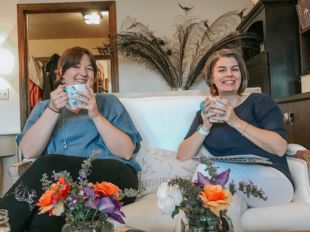Women drinking tea on couch