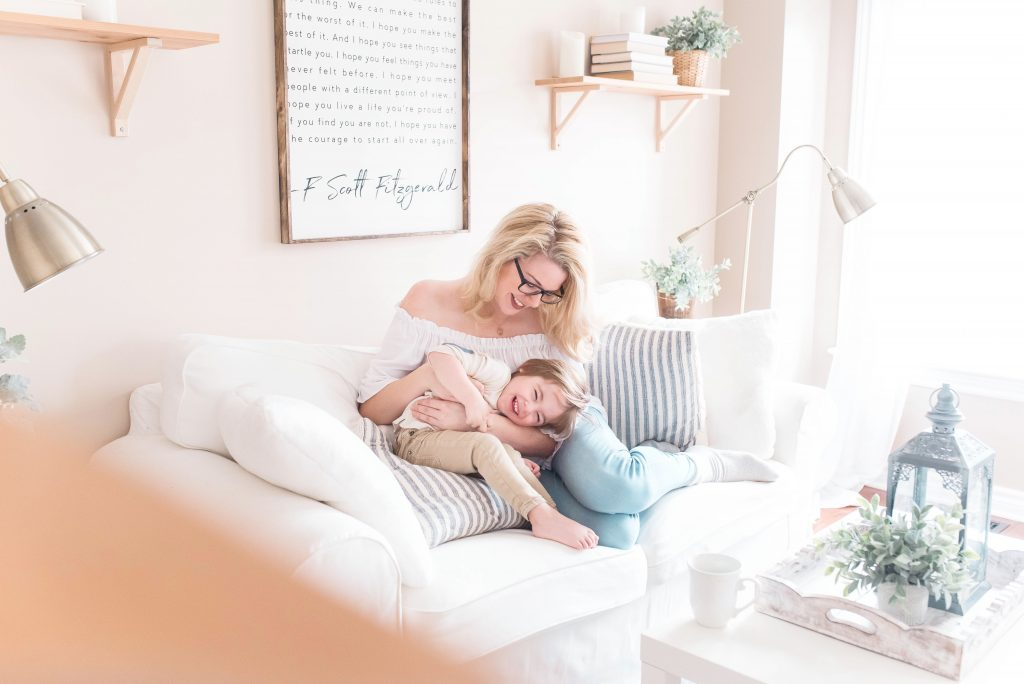 Woman and child snuggling on couch