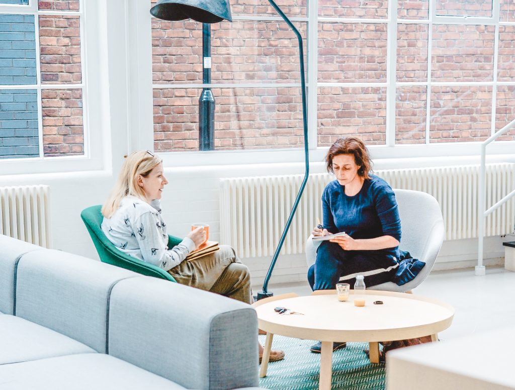Women talking and listening in an office