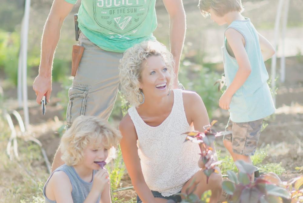 Vicki Norris in garden with her boys