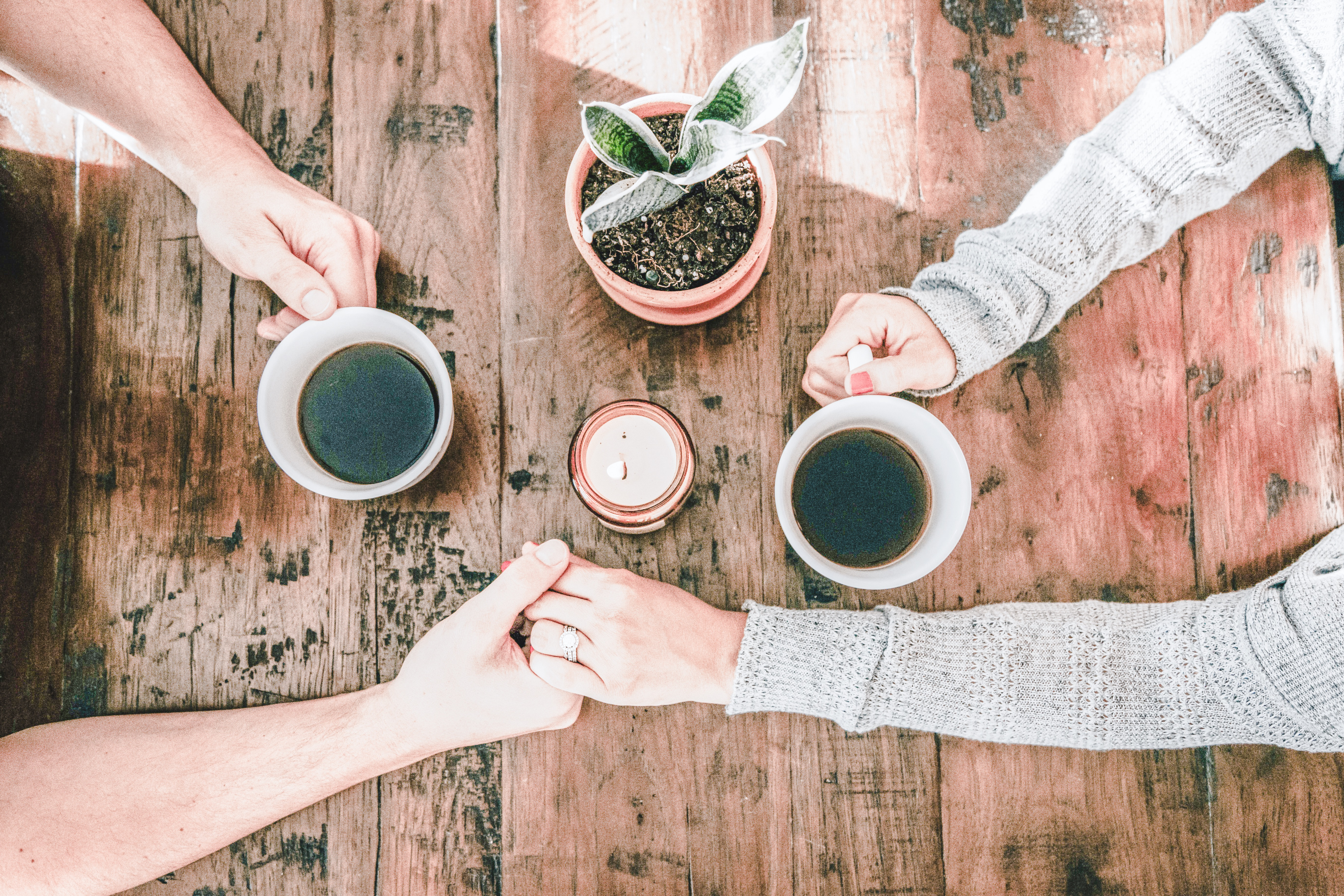 Organizing is Like Therapy - Friends holding hands with coffee