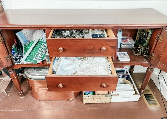 Cluttered storage sideboard