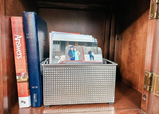 Storage furniture with photo cards and books