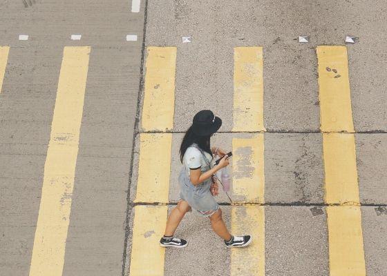 Ditch Distraction - Woman walking across street