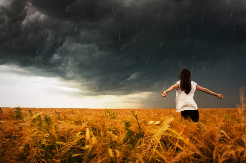 Woman in middle of a storm of conflict