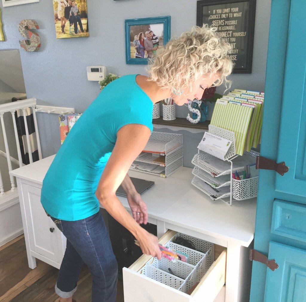Vicki Norris organizing a desk drawer
